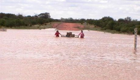 Jade and Kellie rafting the stores across Cardenyabba Creek.